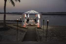 Dine under the stars at Al Raha Beach Hotel