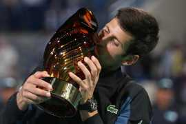Novak Djokovic comes from behind to win Abu Dhabi title