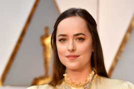 Dakota Johnson flaunts Cartier jewels at the 89th Academy Awards