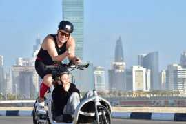 Father to run, cycle and swim 800km with disabled son
